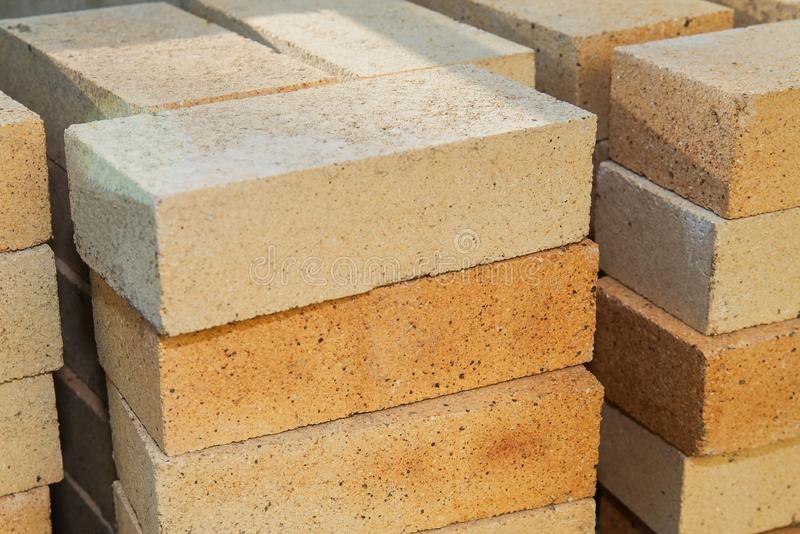 pile-yellow-sand-bricks-construction-site-163882474-1.jpg