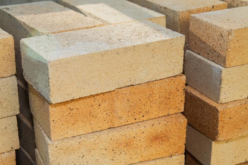 pile-yellow-sand-bricks-construction-site-163882474.jpg